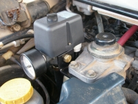 Pressure switch mounted to fuel filter.